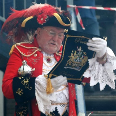 town crier at Marie Curie fundraising event
